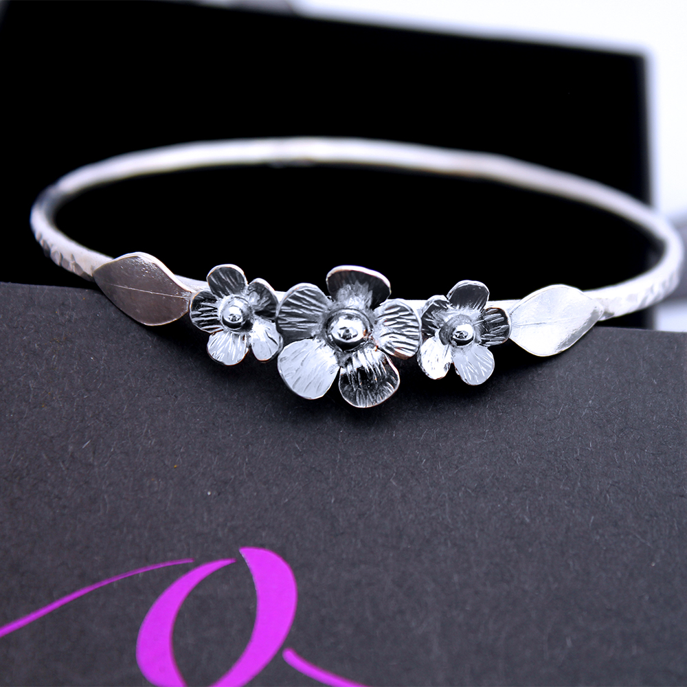 Sterling Silver Hammered Bangle With Flower Garland