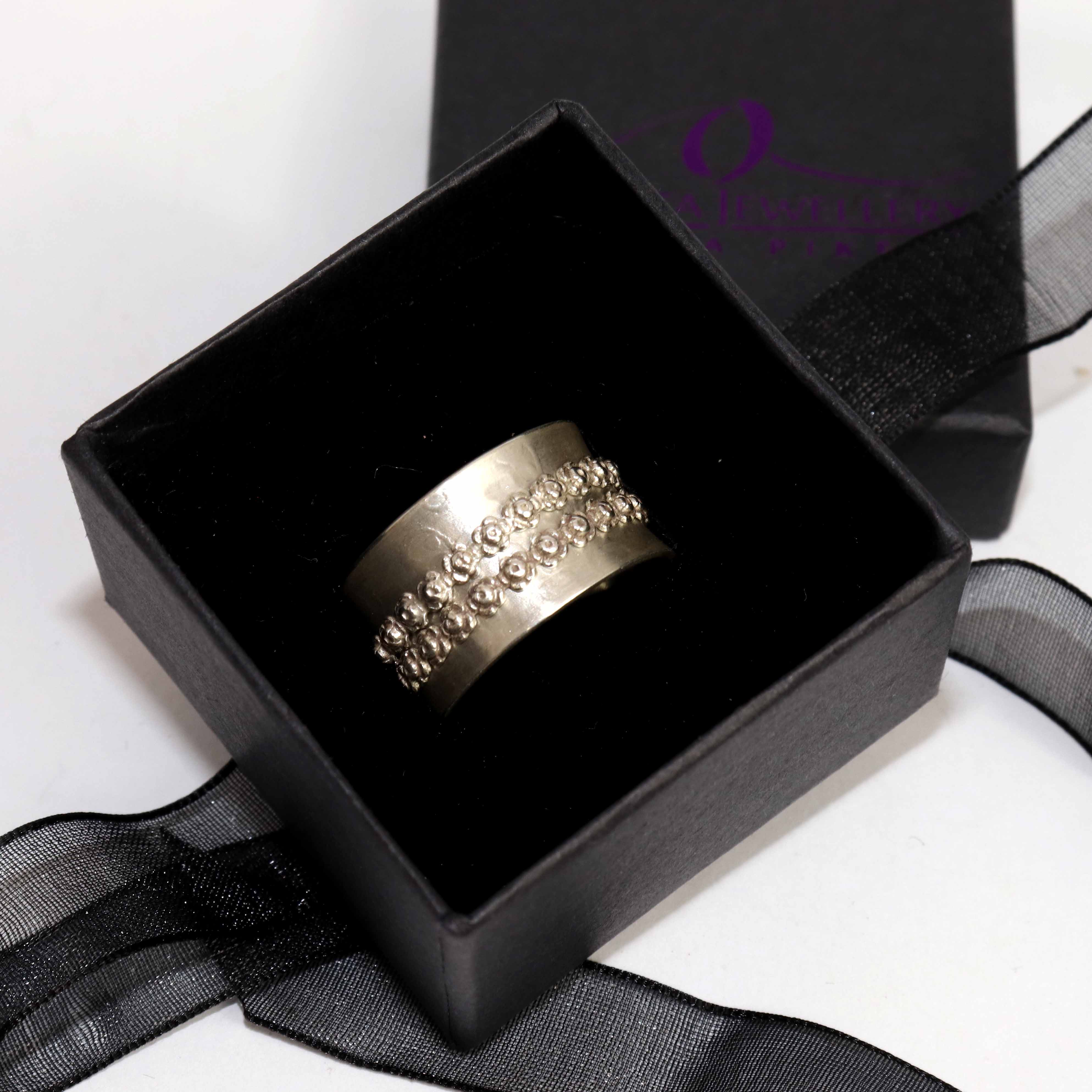 Spinner Ring With Satin Finish And Double Flower Hoop Spinners